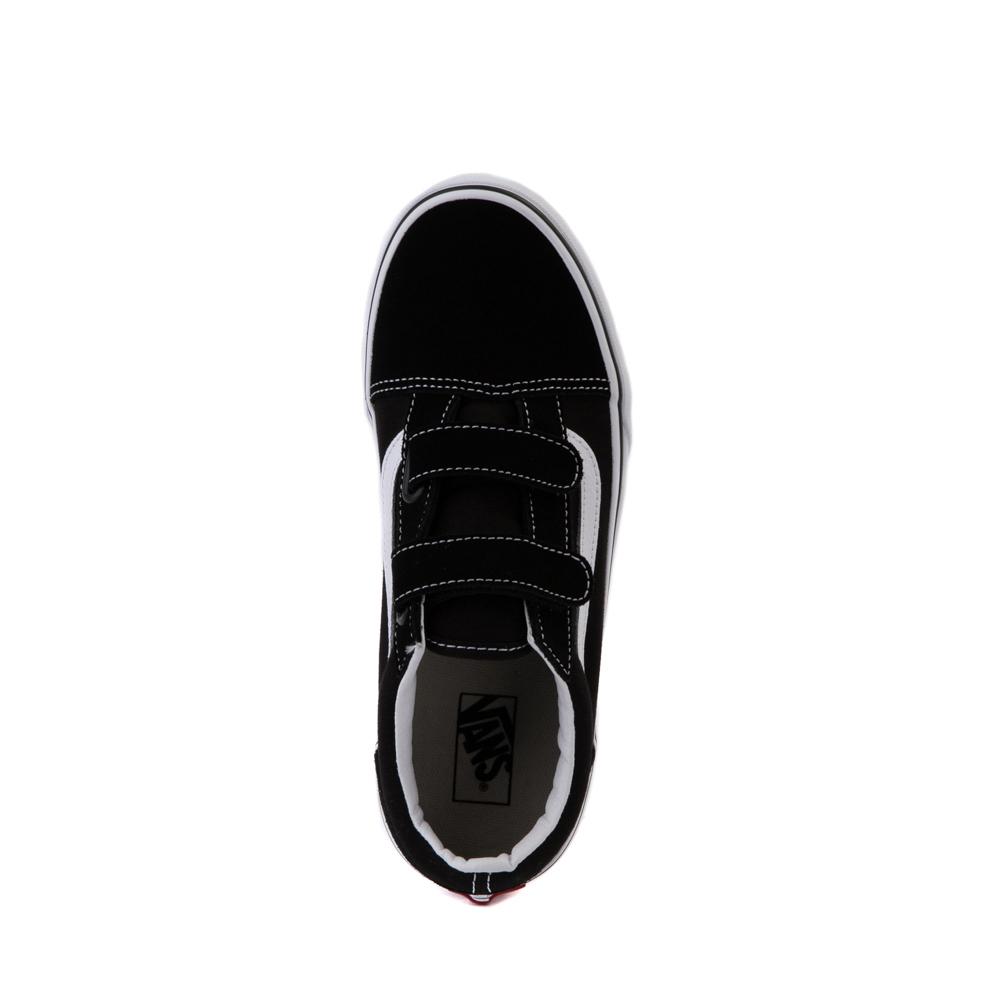 all black vans junior